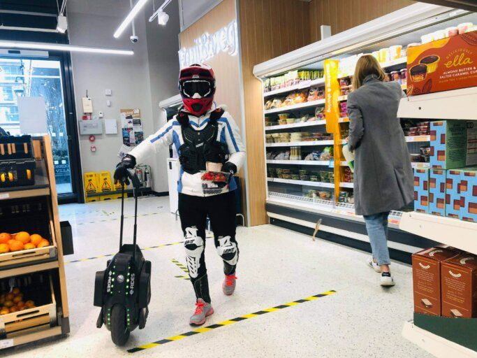 Emily with Kingsong 16X electric unicycle wearing LEATT Protective Gears