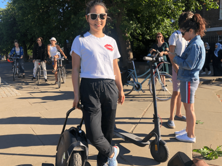 Emily Chen showing off latest electric unicycle and scooter